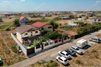 vila situata departe de zgomotul orasului, intr-un cadru linistit al satului COSTI, com Vanatori, cartierul nou